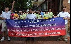 3 Marchers Hold ADA Banner at Start of Parade