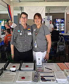 Barrie with Health Department staffer Paula Bradshaw at the NY State Fair Pride Day Outreach Area